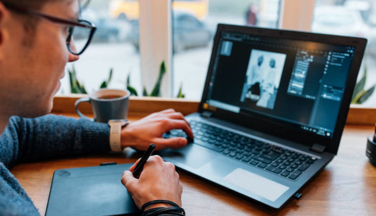 man editing photos on his computer