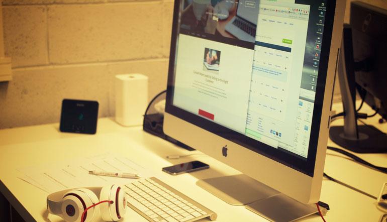 iMac aluminum near block computer