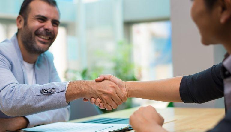 happy men handshake