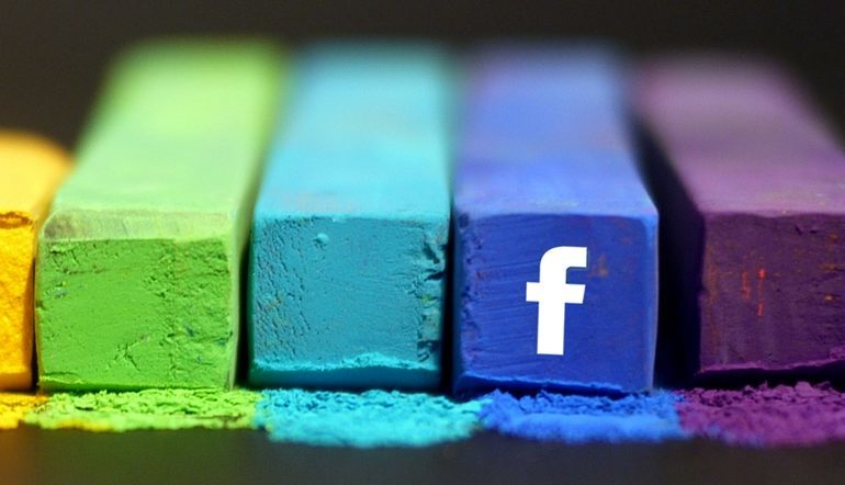 colorful chalks with one facebook logo