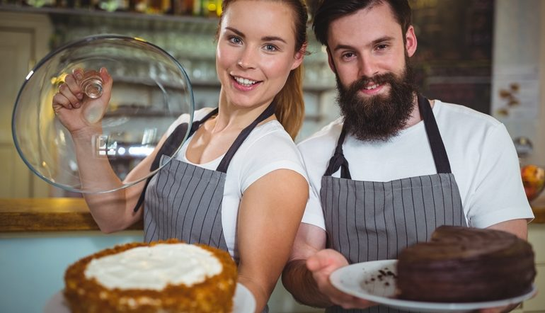man and woman holding cake