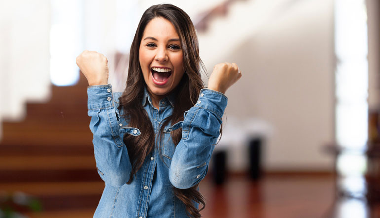 over excited young woman wearing denim shirt