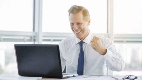 happy man working on his laptop