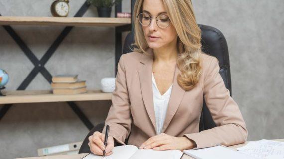 executive woman writing notes
