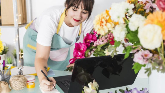 happy female florist writing