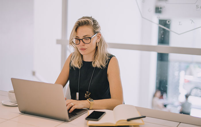 woman using laptop while working