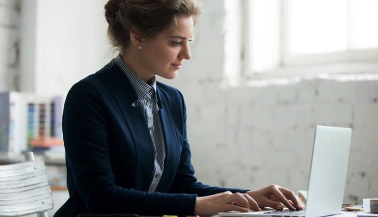 corporate woman working on her laptop