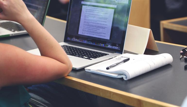 woman writing resume