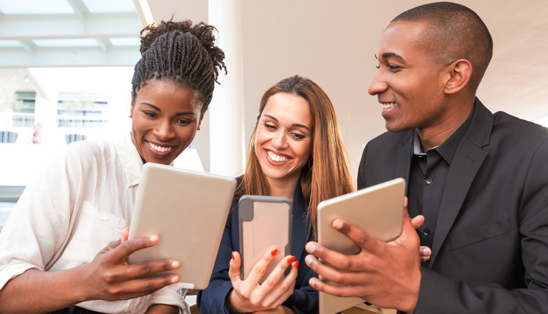 group of people checking their mobile devices