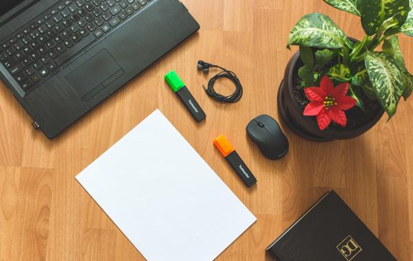 black laptop near white paper
