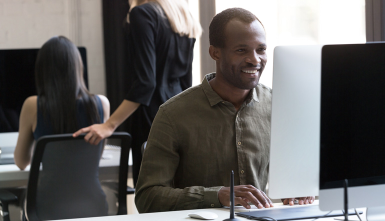 Smiling african american while working
