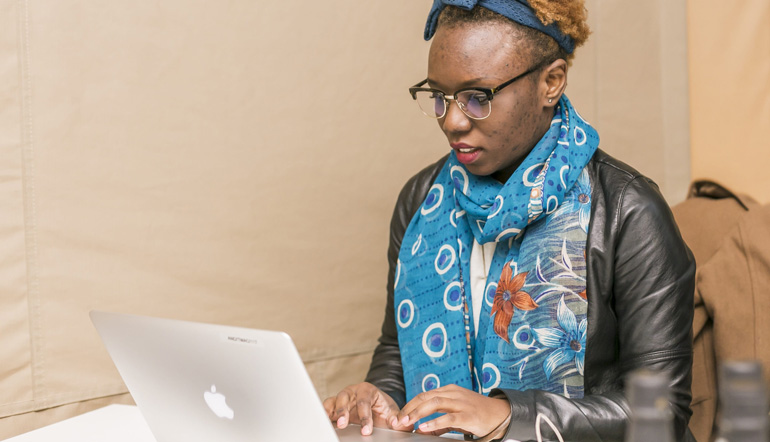 African woman working using with her laptop