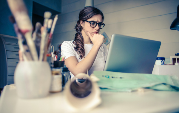 woman thinking while working