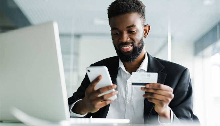 African man transact online using his mobile phone