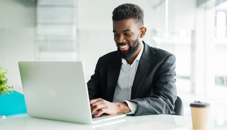 african american businessman using laptop
