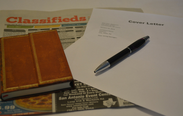 pen book top of the news paper