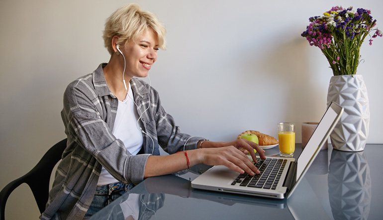 cheerful woman with silver laptop