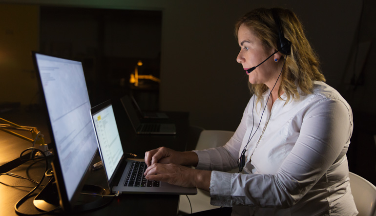 Female call center operator in headset