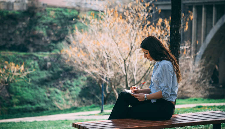 Girl studying in a park